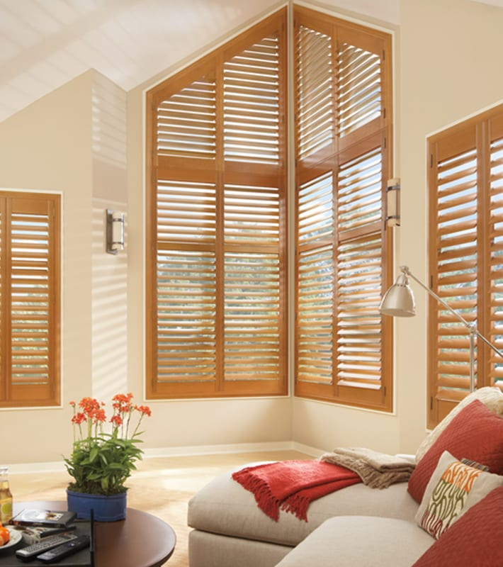 wood shutters for large angled living room windows