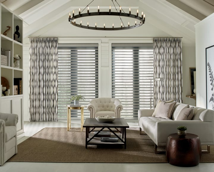living room with automated drapery panels and pirouette shades Houston TX