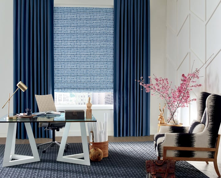 blue patterned fabric roman shades and blue drapery panels Houston TX