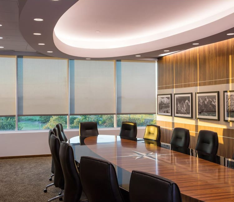 office conference room in houston with roller shades on exterior windows