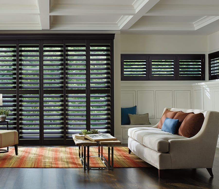 living room large window hardwood shutters Houston TX