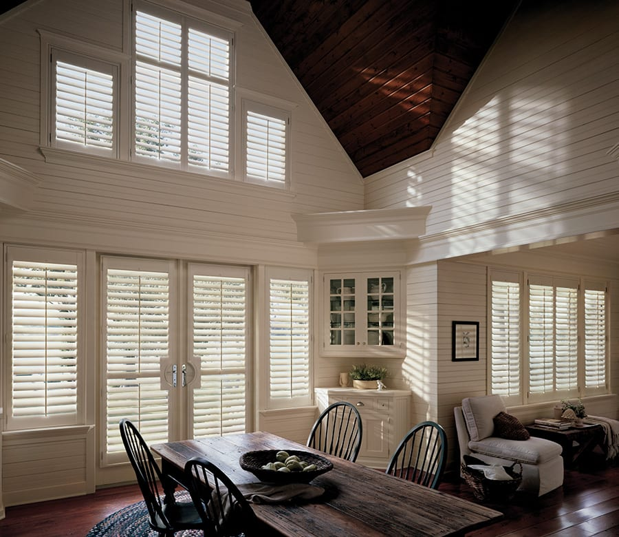 dining room open concept white hardwood shutters Houston TX