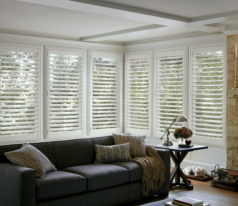 living room large windows Hunter Douglas sliding doors wood shutters Houston TX
