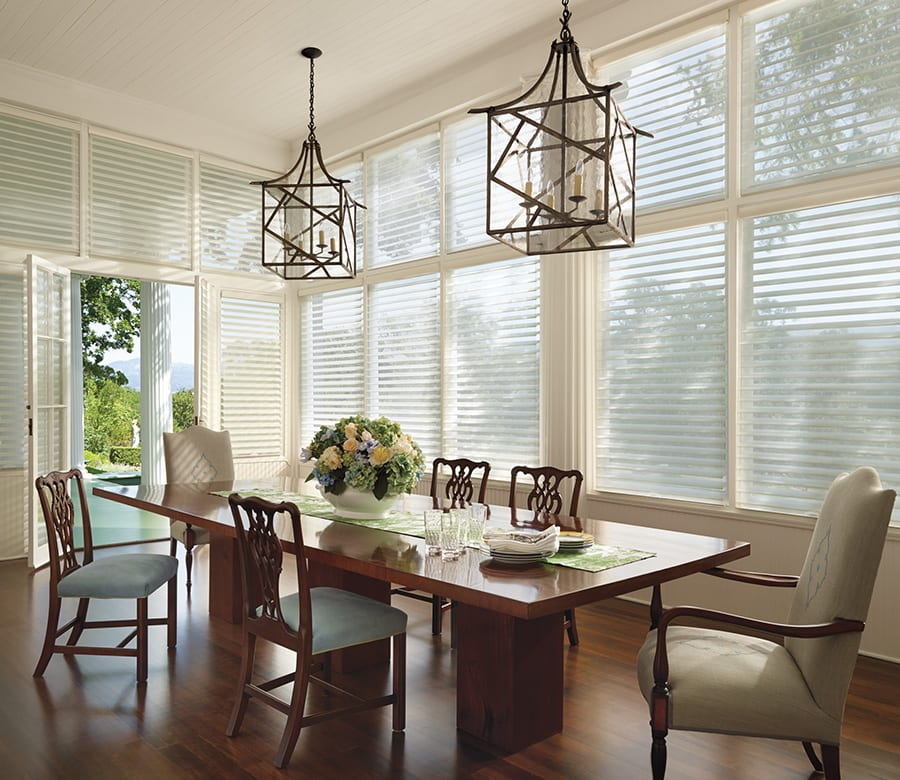 dining room large windows glass doors silhouette shades Houston TX