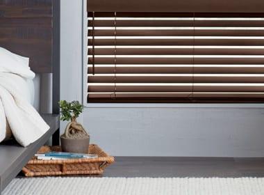 dark brown wood blinds in Baybrook home