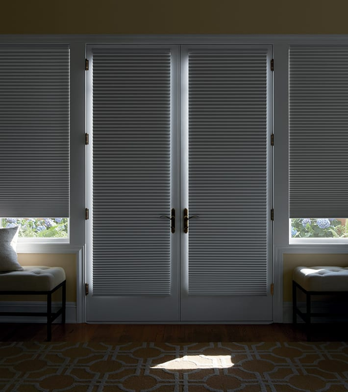 french doors with room darkening blinds covering windows and glass doors Houston TX