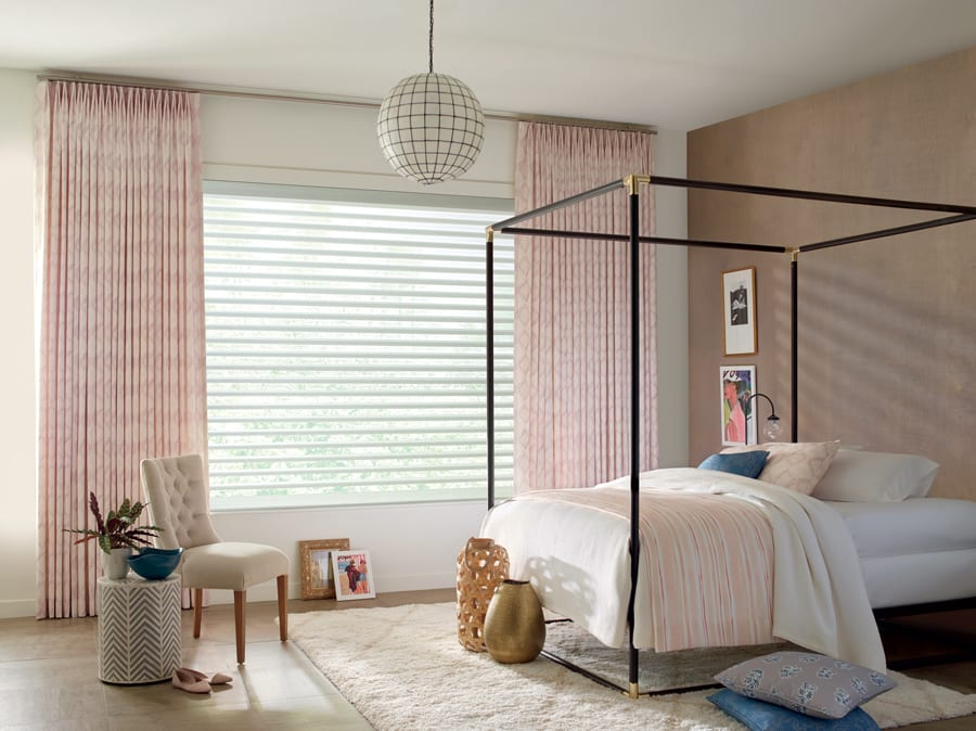 Bedroom in Houston home with layered look from Design Studio window treatments