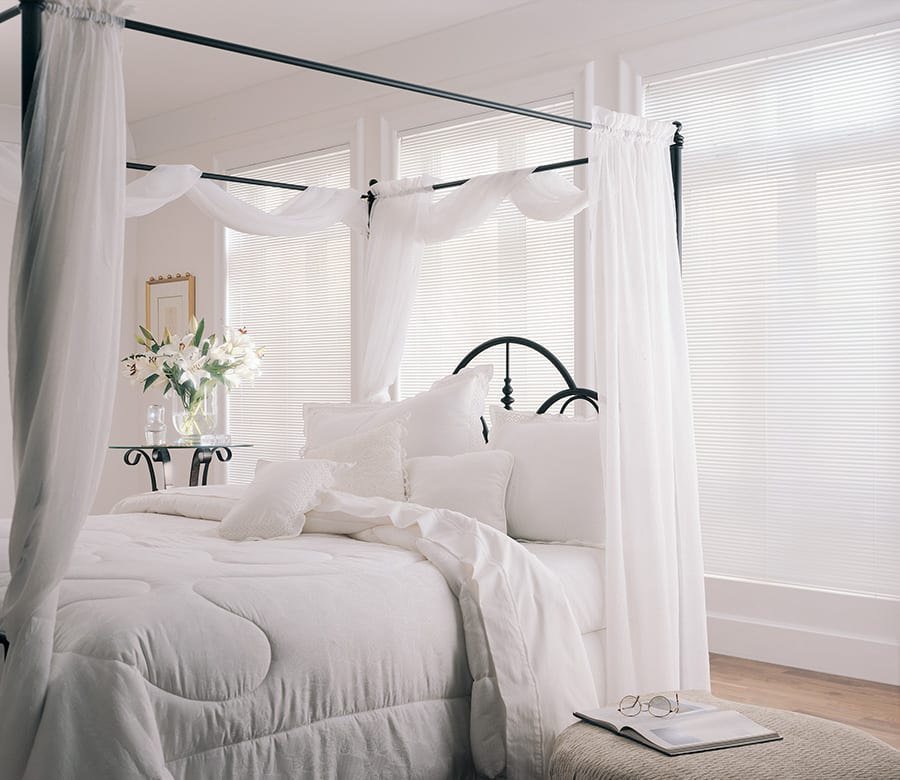 white aluminum blinds in white bedroom Houston TX