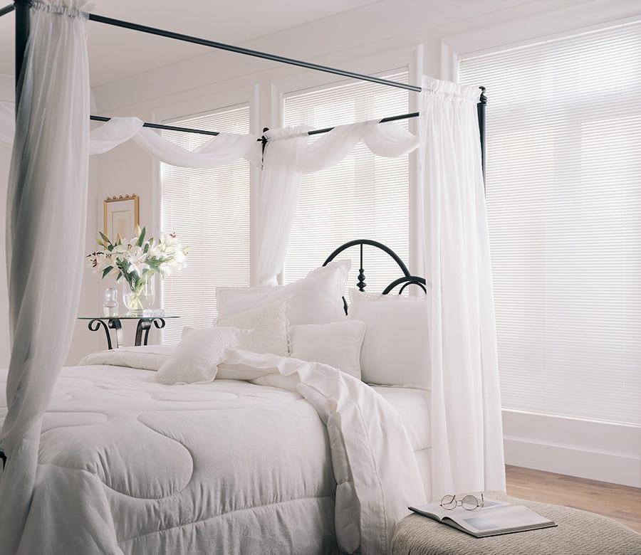 white aluminum blinds in white bedroom Houston TX