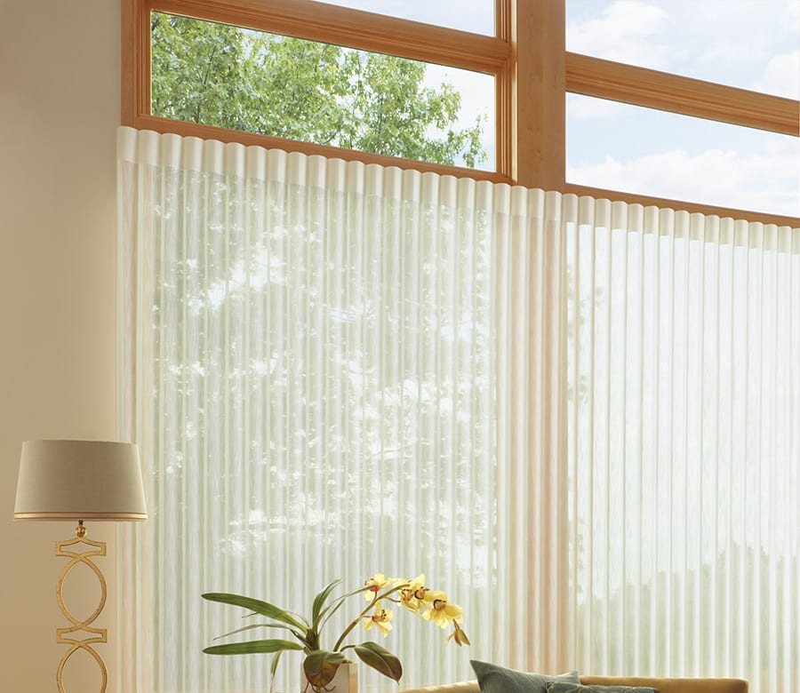 living room large windows with vertical blinds luminettes Houston TX