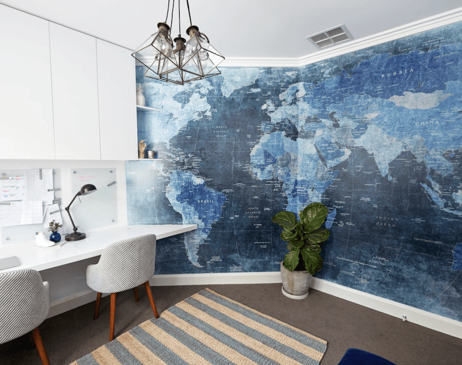 world map mural in blue color of the year 2020