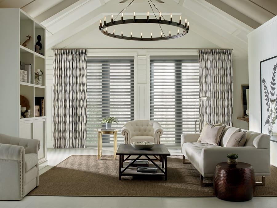 custom window treatments motorized drapery panels in Houston living room