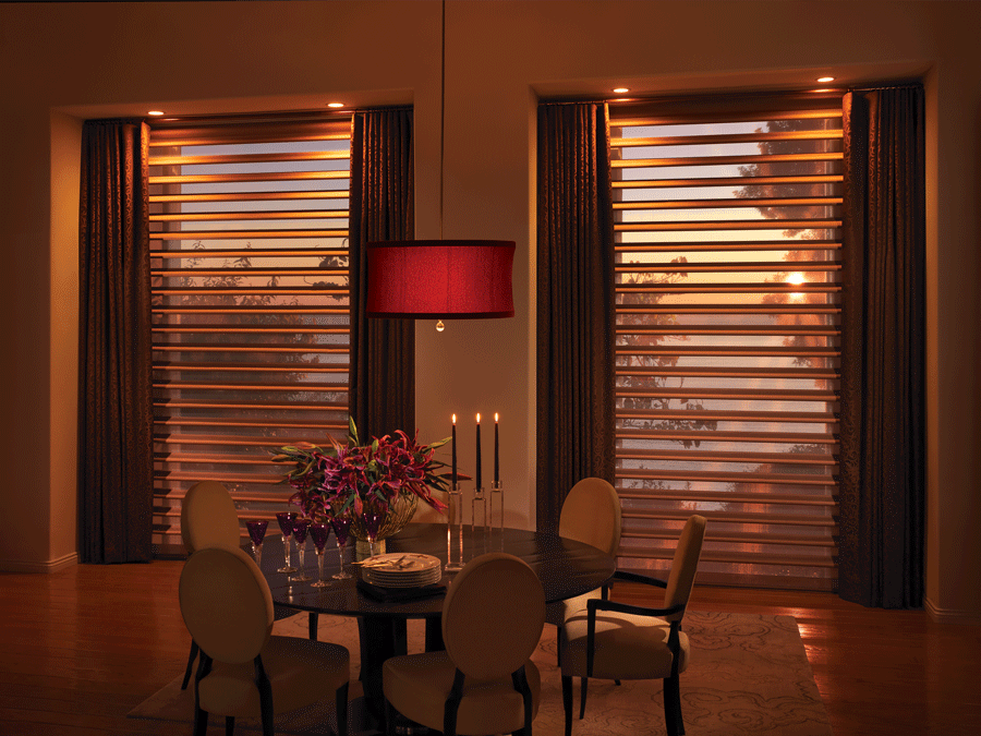 dining room with pirouette shades creating atmosphere with light filtering sheer fabrics Woodlands, TX