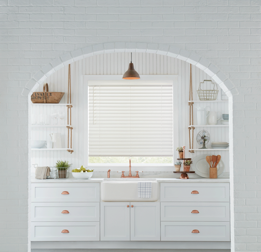accents of gold hardware in white kitchen with white window blinds Houston TX