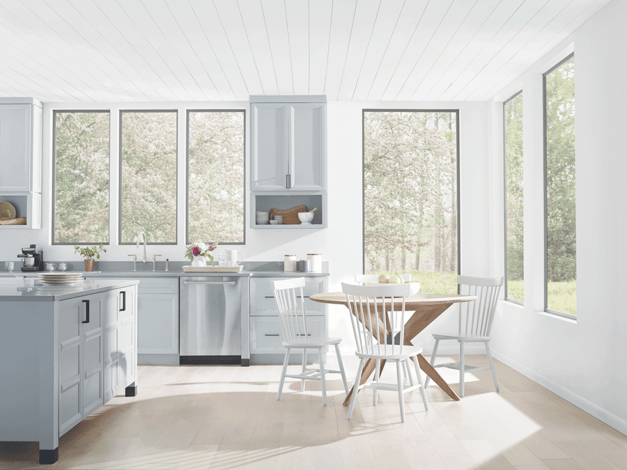 Kitchen with no window treatments is drowning in natural light.