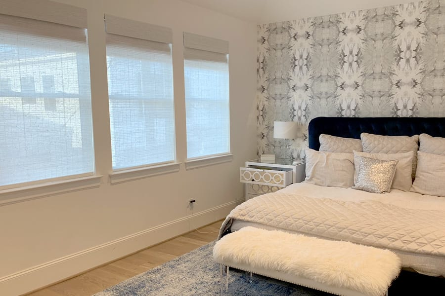 gray and white bedroom in Baybrook TX with dual roller shades