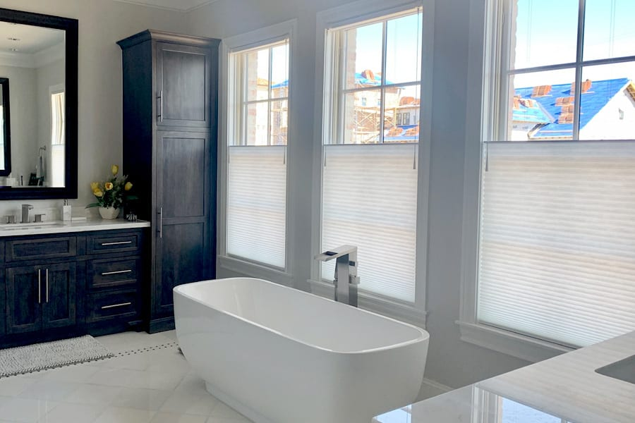 modern bathroom with white top down shades soft touch motorization Houston TX