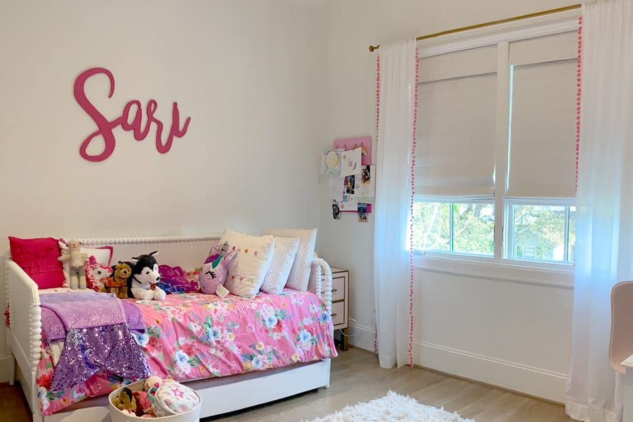child's bedroom with fabric roman shades and decorative side drapery panels Memorial TX