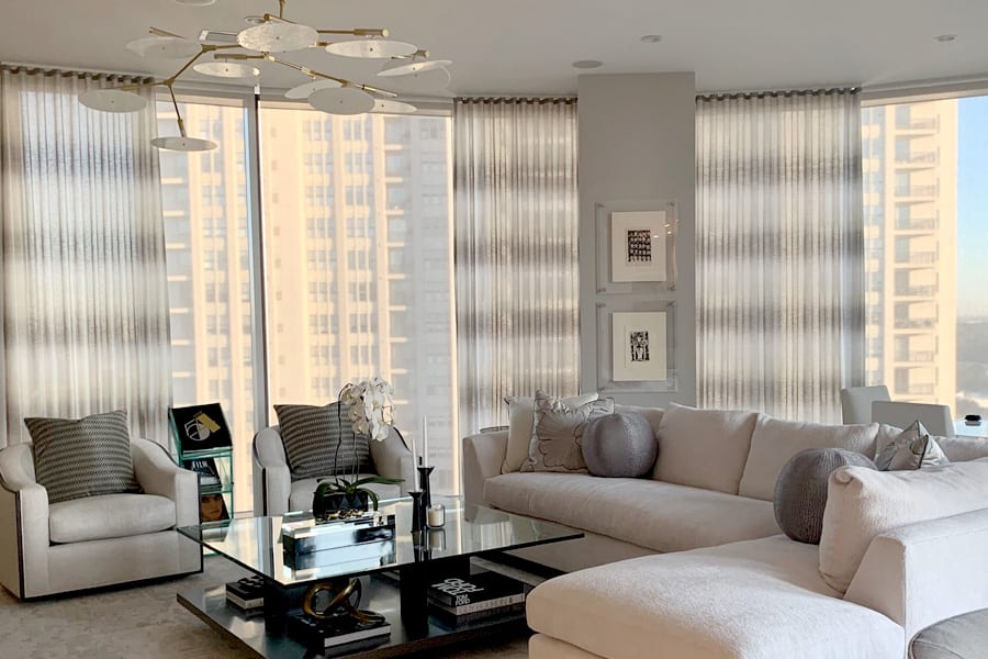 high rise building floor to ceiling windows luminette privacy sheers
