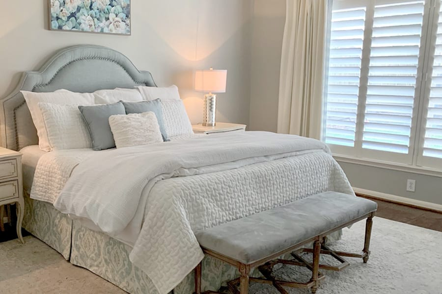 white shutters in bedroom with side drapery panels Houston TX