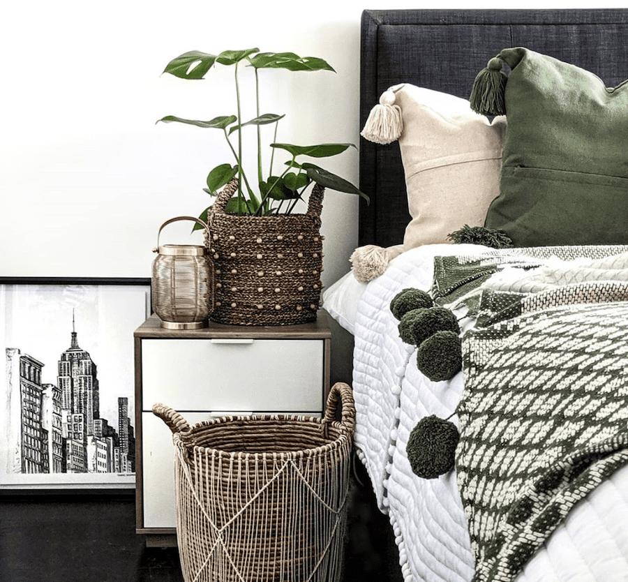 bohemian bedroom styling woven basket blanket with tassels