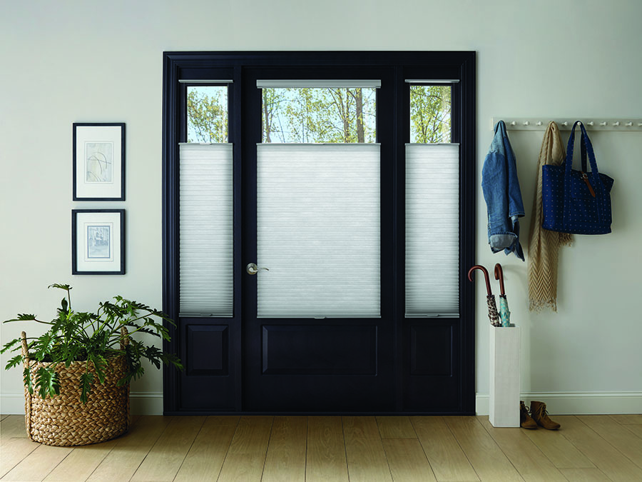 Glass front door features top-down window shades for home protection
