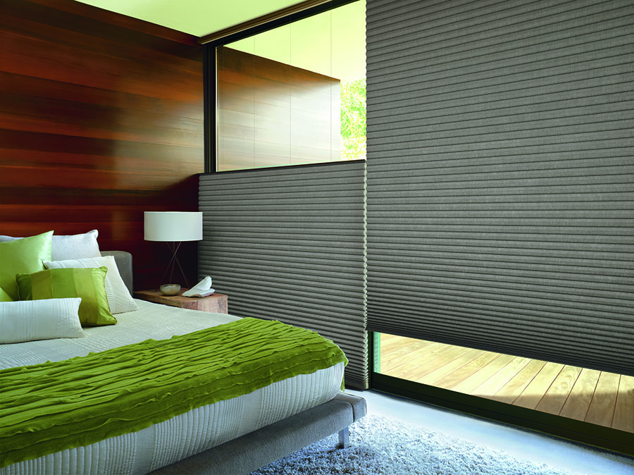 Top-down bottom-up window coverings add privacy to this bedroom