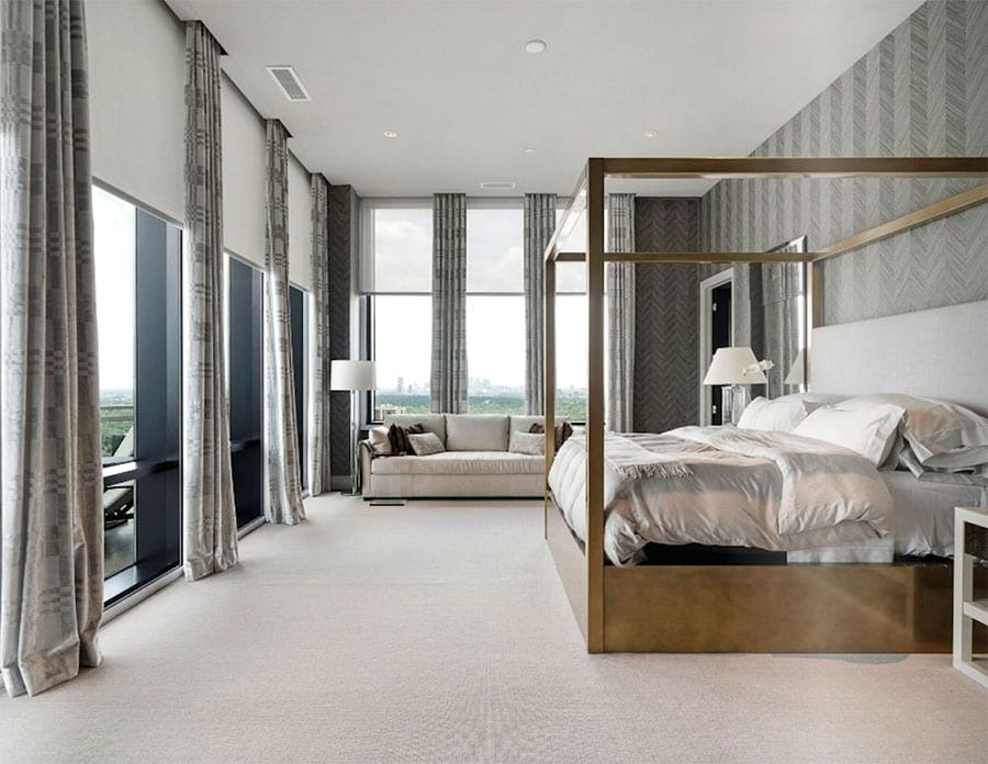bedroom with floor to ceiling window shades layered with draperies Houston TX