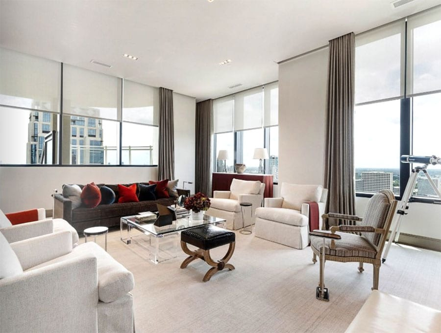 houston living room with floor to ceiling windows draperies and shades