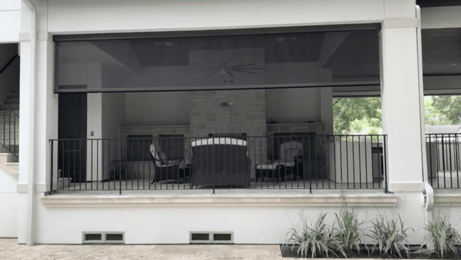 protecting your patio space with black view through motorized patio shades Memorial, TX