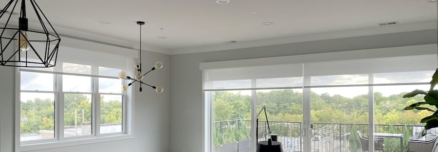 dual motorized shades with rechargeable batteries hidden in headrail Houston TX