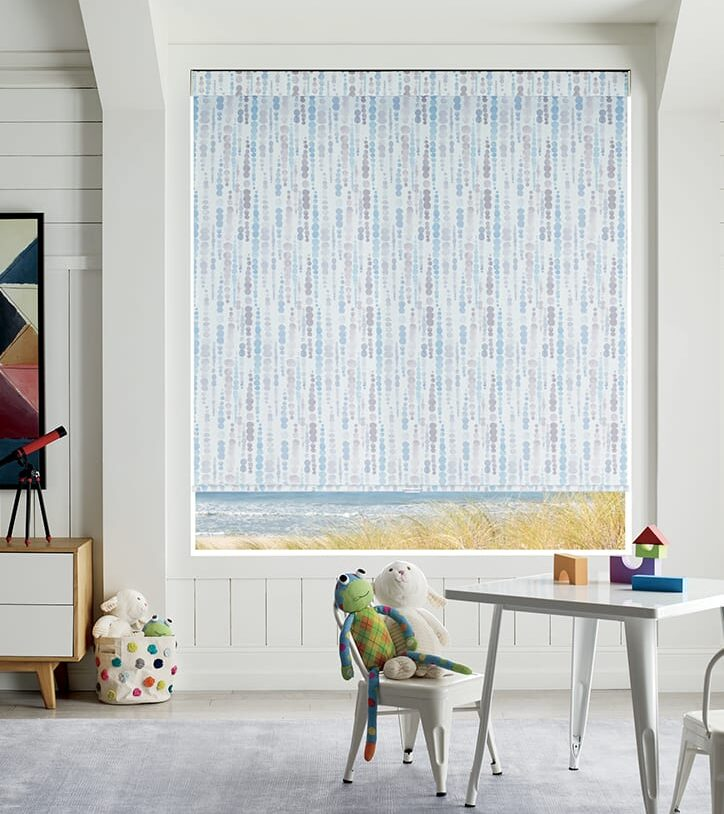 blue patterned cordless roman shades as child safe blinds in Houston playroom