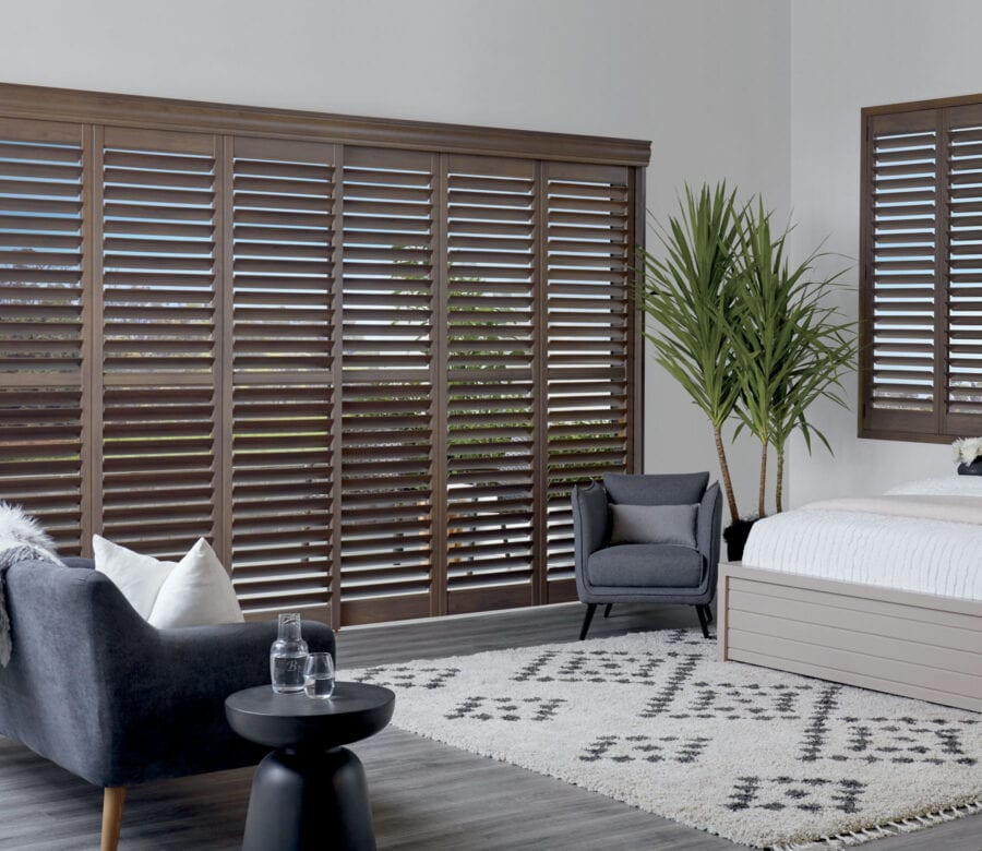master bedroom tilted view of newstyle hybrid shutters houston texas