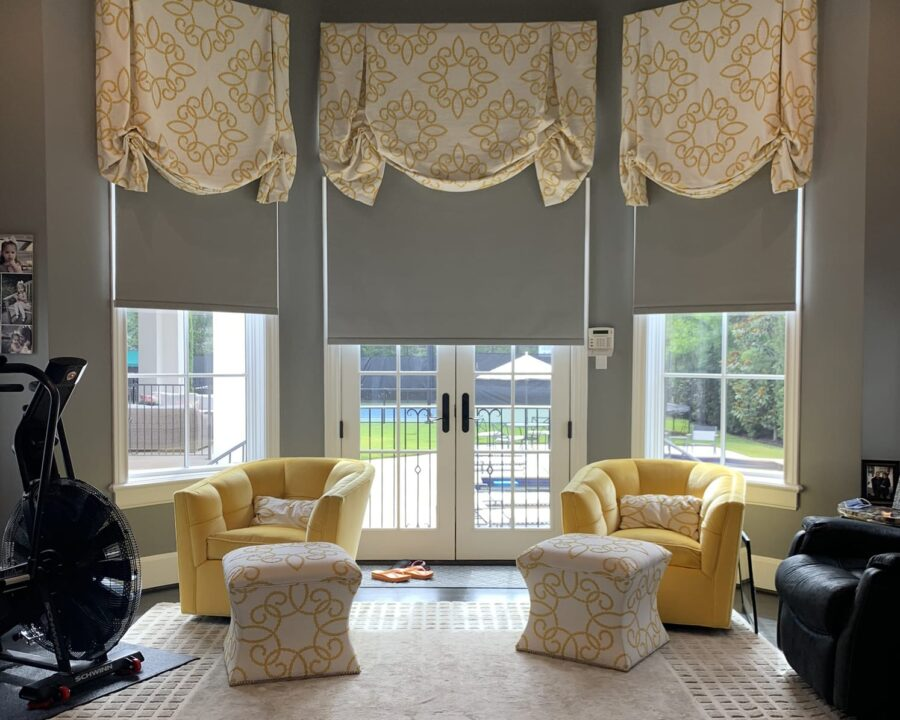 gray and yellow decor in home with patterned top treatments and gray roller shades in Friendswood TX