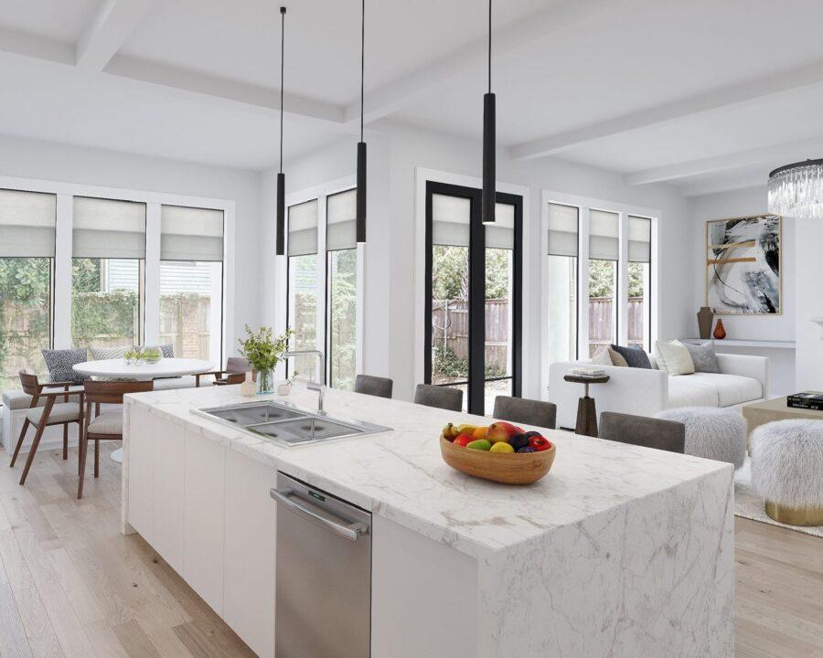 open floor plan with white kitchen and white shades on windows in Houston TX