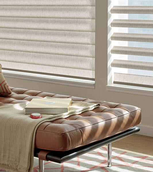 leather bench seat next to windows with automated pirouette shades in Baybrook TX