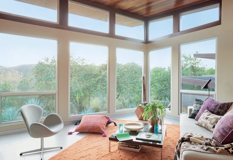 bare windows energy loss livingroom houston TX