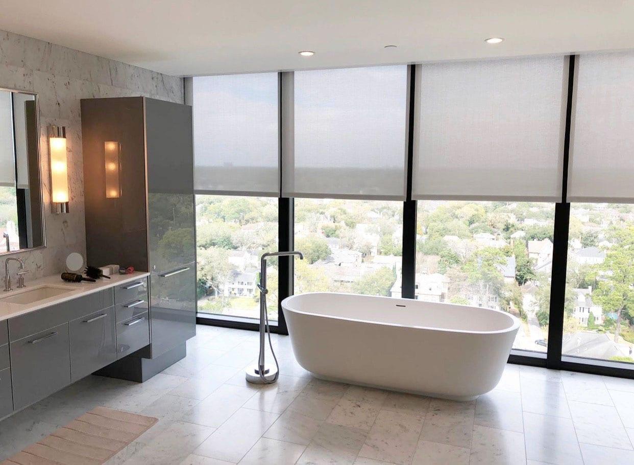 bathroom ideas include modern concrete bathroom with gray roller shades in Houston TX