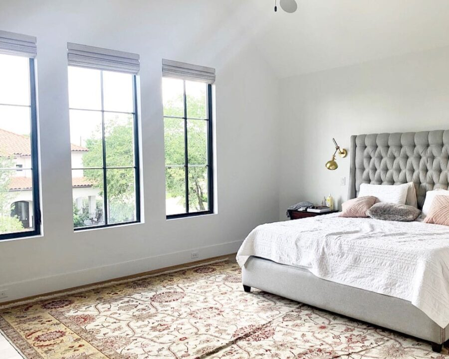 master bedroom with black frame windows and roman shades in Houston TX