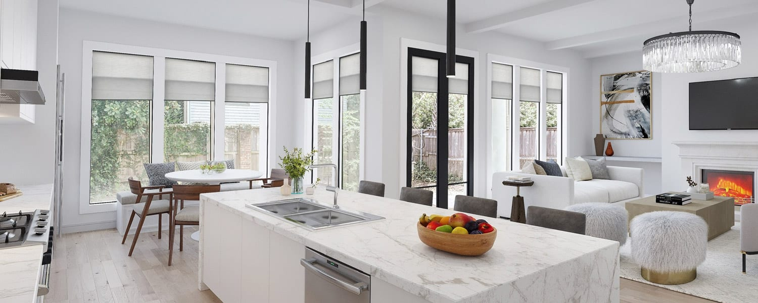 white marble kitchen with matte black fixtures and gray honeycomb shades in Houston TX
