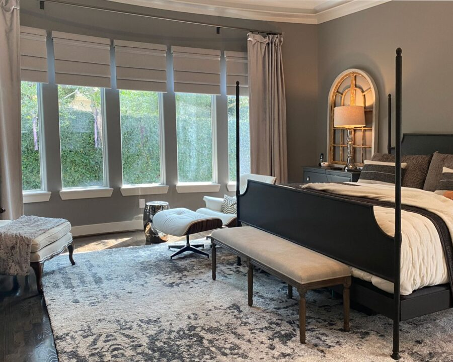 bedroom with draperies and neutral roman shades in Friendswood TX