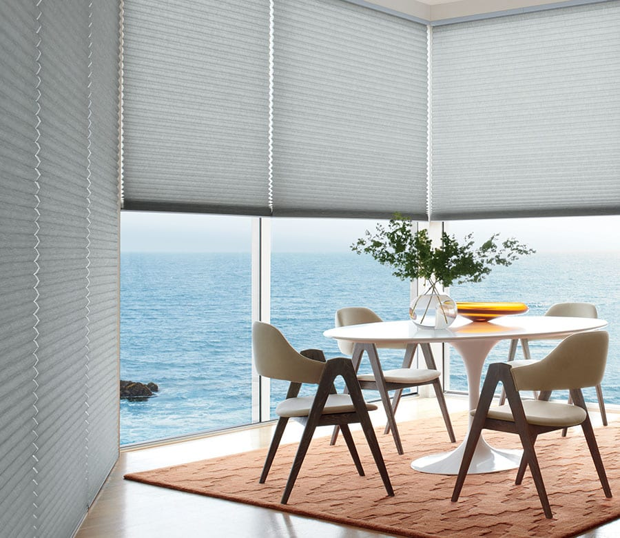dining room with floor to ceiling windows covered with honeycomb shades in Baybrook TX