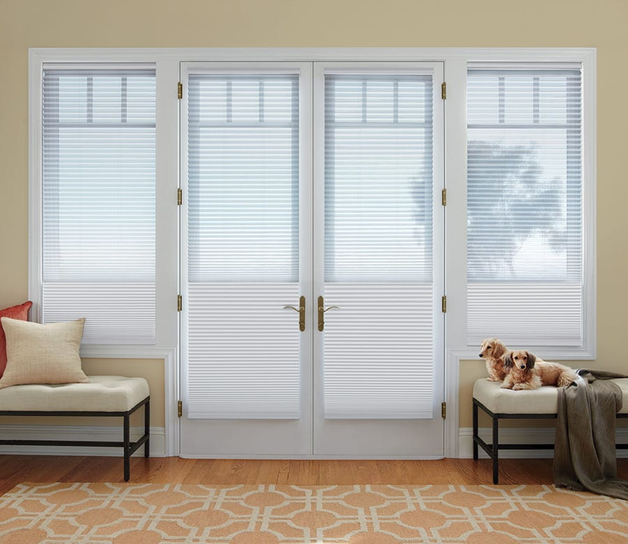 french door entryway with white cellular shades in Rice Village TX