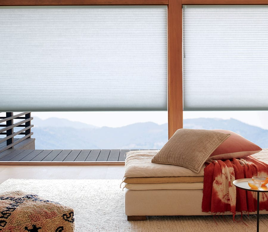 light gray cellular shades on large windows in Memorial TX living room