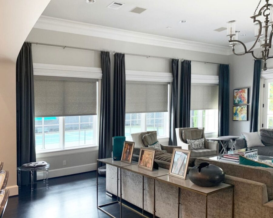 living room ideas for home with dark drapery panels and roller shades in Magnolia TX