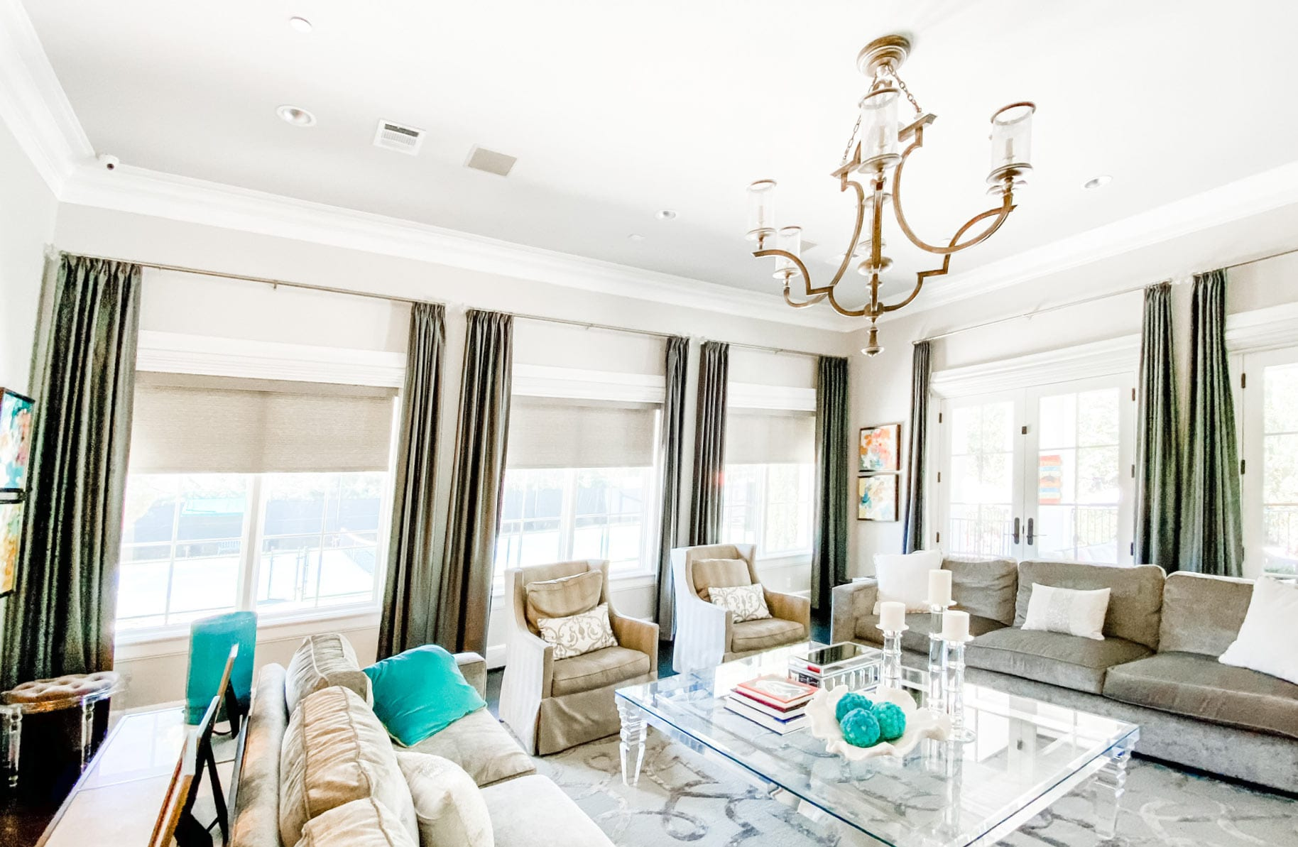 beige roller shades with olive green drapery in Houston living room