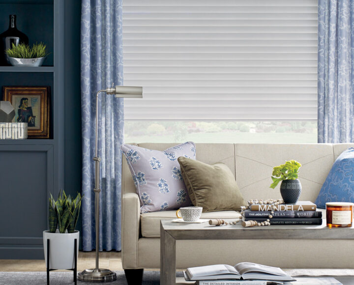 white cellular roller shades in houston TX home with blue draperies