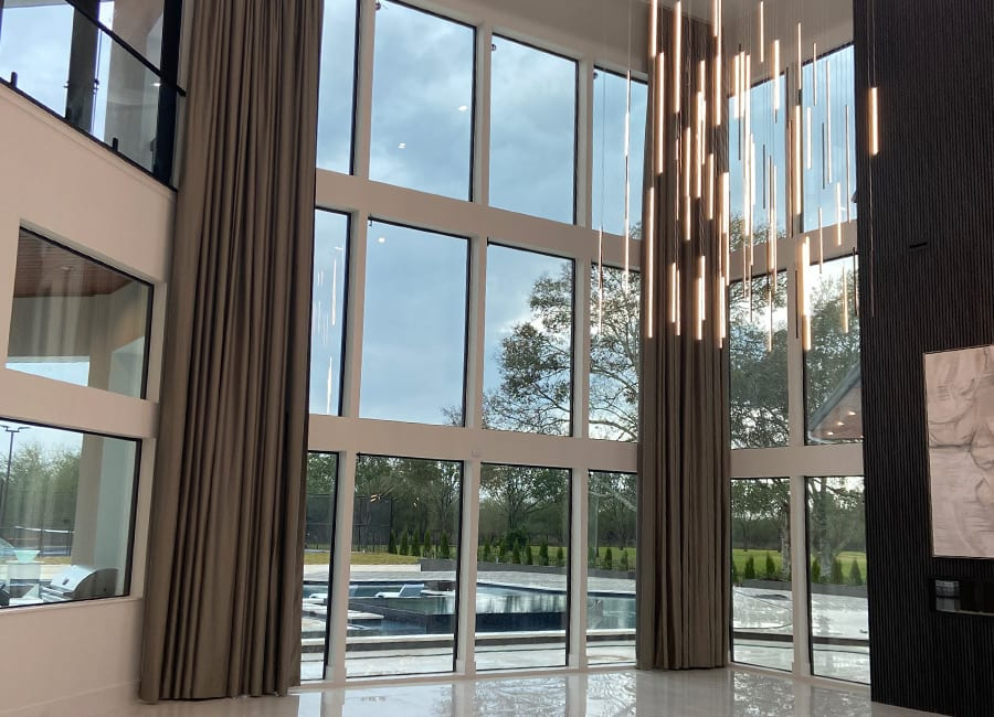 tall ceilings with custom draperies Rice Village TX