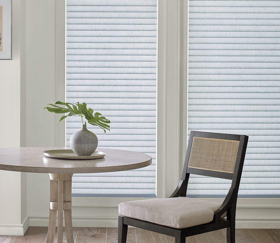 gray roller shades with insulating properties in Memorial TX