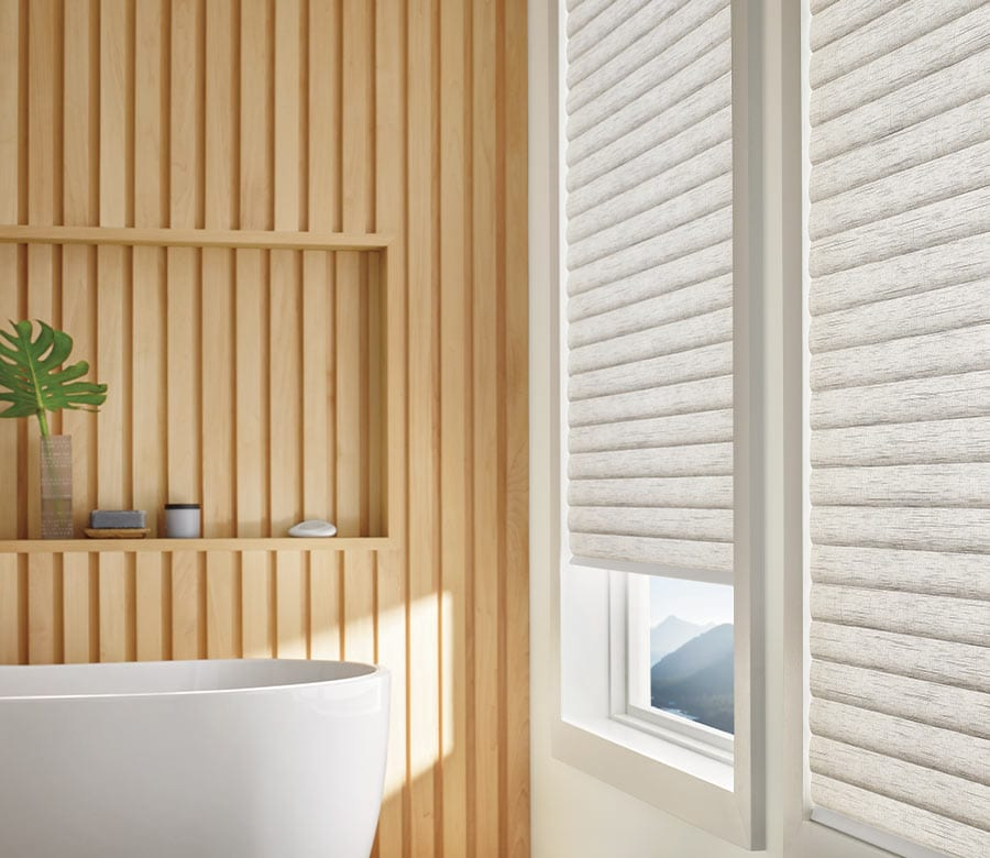 bathroom windows covered with cellular roller shades in Friendswood TX